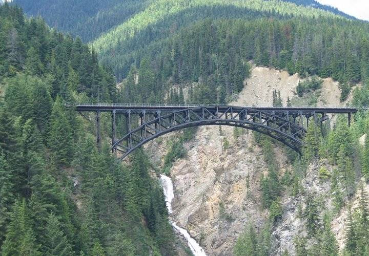 bridge, mountain, water, travel, river, landscape, no person, wood, valley, nature, outdoors, scenic, tree, sky, highway, viaduct, transportation system, rock, road, daylight