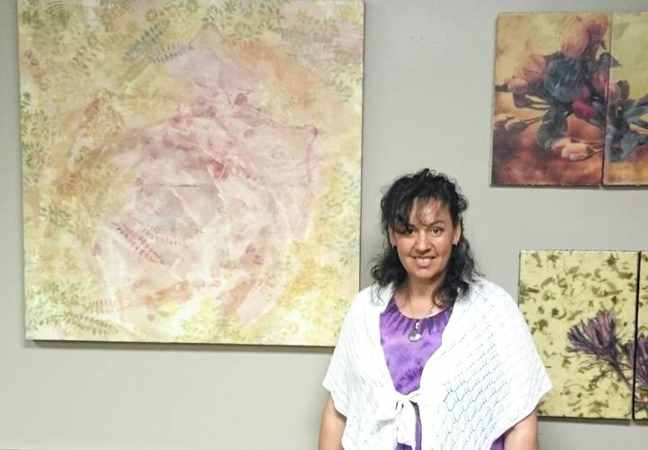 Karen Brown and some of her encaustic paintings