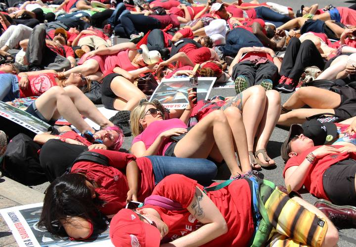 "Protesters lay during the ""de-in"" demonstrating animals killed."