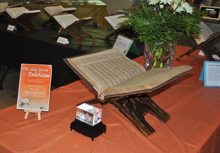 Display of a Quran from over a 100 years old with english translations.