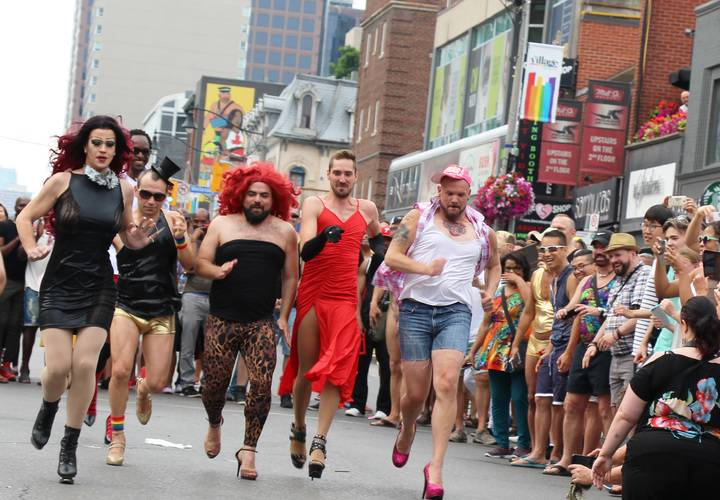 Contestants race during the Annual High Heel Strut competition.