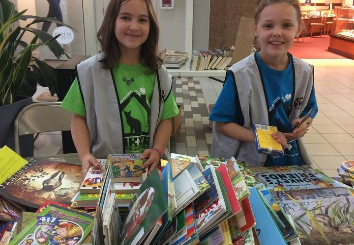 Calla and Mia,  energetic volunteers selling childrens' books,