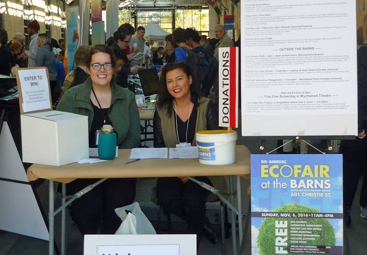 Volunteers welcoming attendees to the EcoFair.
