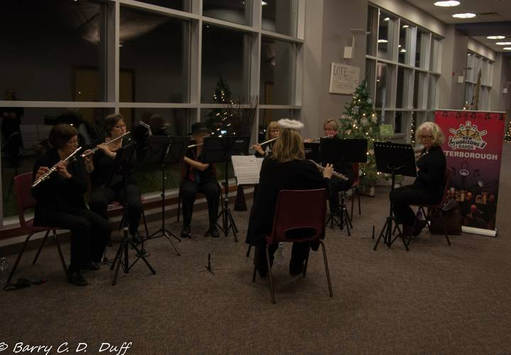 Small ensemble Flutissimo entertains concert goers in the reception lobby