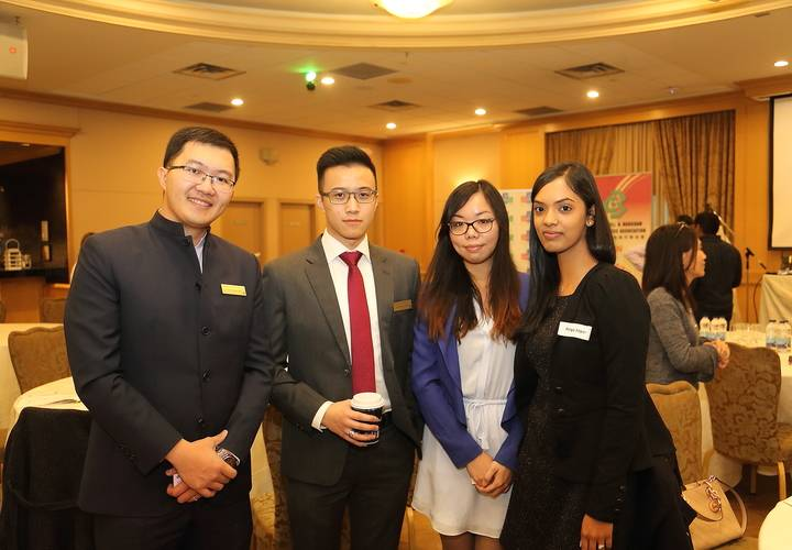 Associate directors Nicholas To (left) and Arthur Cheung mingle with attendees.