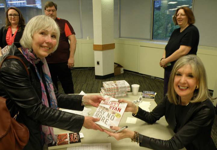 Hank Phillippi Ryan signs her books