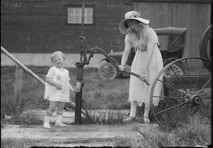 A woman is pumping water at a well in king city  ontario resized