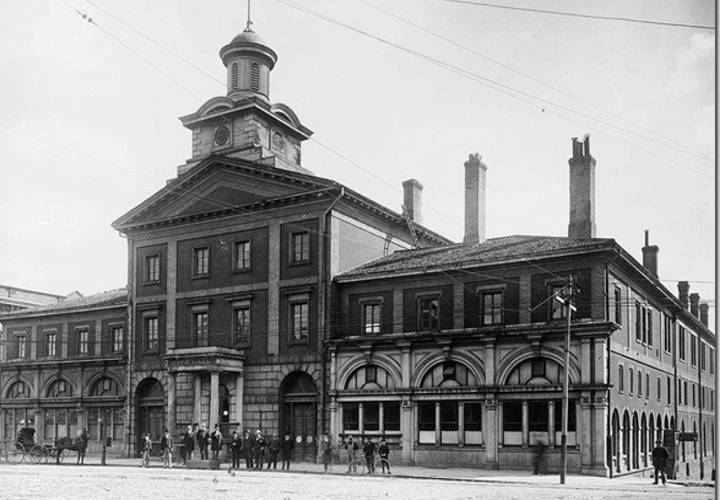 The 1845 city hall at front and jarvis street . the centre section of this building forms part of the present day st. lawrence market. the side sections  pediment and cupola were demolished