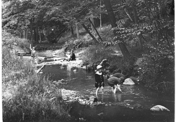 Kids playing in the creek in wychwood park in 1916 resized